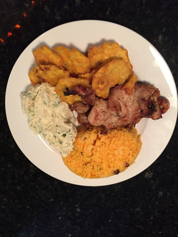 Chicken and rice, with tostones and potato salad.