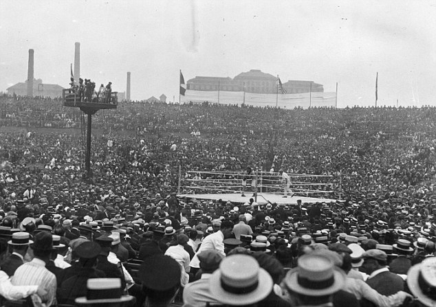 2nd July 1921: A general view of the crowd watching the world heavyweight title fight between the current champion Jack Dempsey of the USA and French contender Georges Carpentier at Boyle's Thirty Acres in Jersey City, New Jersey. Dempsey retained his title with a fourth round knockout. The fight drew the first-ever million-dollar gate. (Photo by Topical Press Agency/Getty Images)