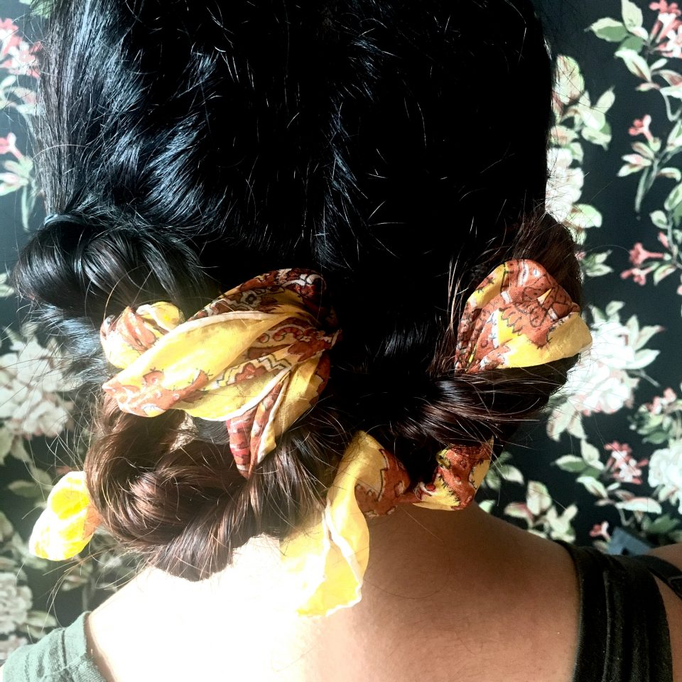 Double Fish Tail Braided Updo Intertwined with a vintage scarf from The Hair Room JC