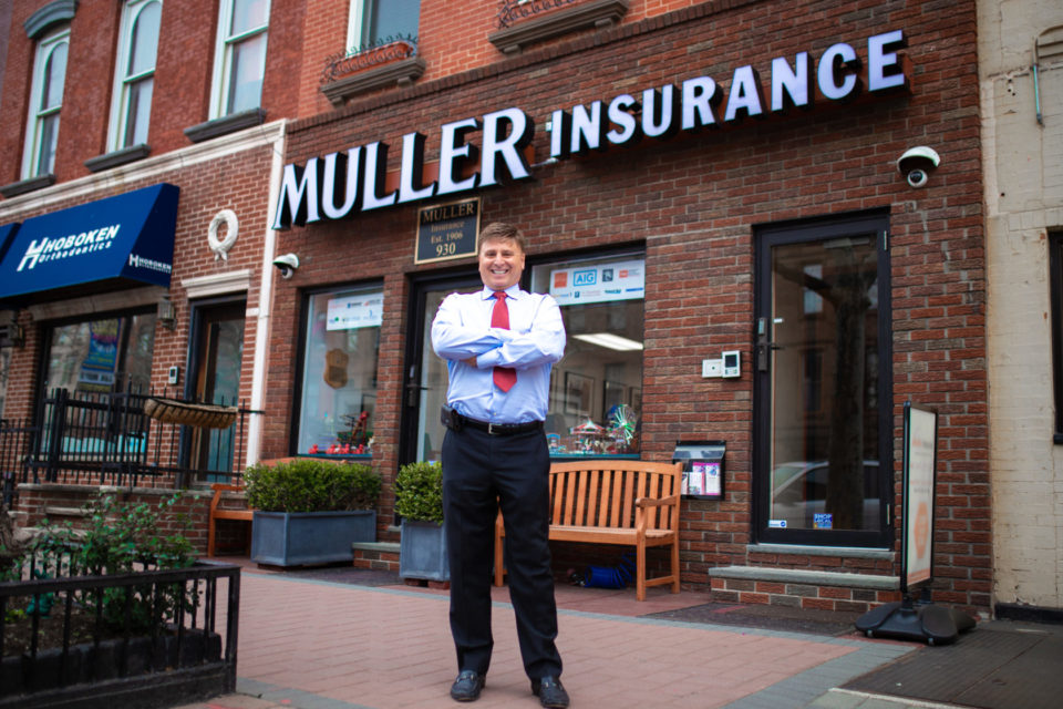Roger Muller in front of office